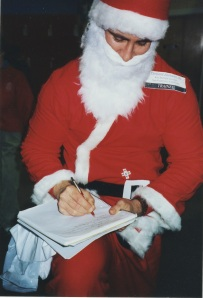 "Santa ""Chuck"" at Cacophony SantaCon (Santarchy, Kringle Klot, Santa Rampage, etc., ad nauseum) Portland 1996. photo by Bob Gelman"